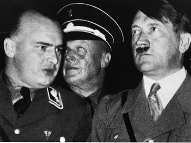Hans Frank, left, confers with Adolf Hitler