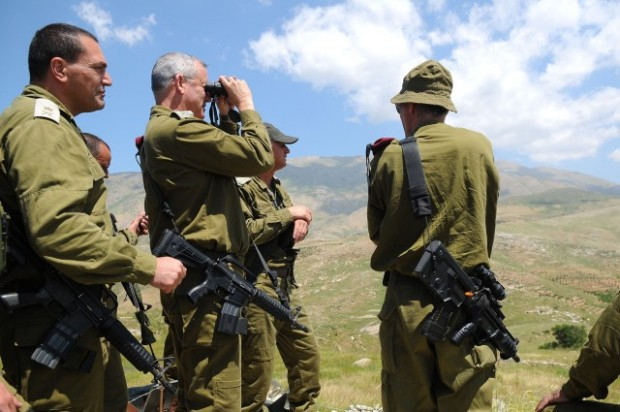Israel's chief of staff, Gen. Benny Gantz, center, surveys the Golan