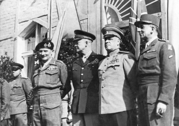 Georgy Zhukov, second from right, stands next to Dwight Eisenhower