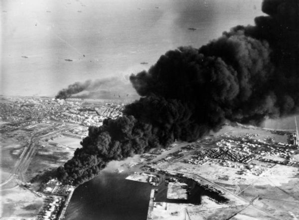 Port Said oil tanks on fire after being bombed by British and French aircraft