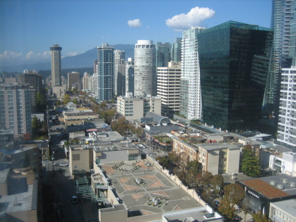 Robson Street, below, leads to Stanley Park, in the far distance