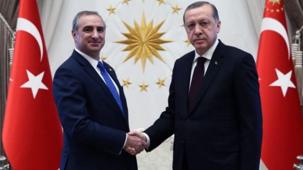 Israel's new ambassador to Turkey, Eitan Naeh, shakes hands with Turkish President Recep Tayyip Erdogan